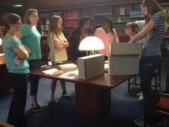 Kilian Spiethoff from Munich Germany visits with the Teens Make History young people in the Missouri History Museum Library and Research Center.