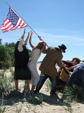 Headed for America: Theatre artists and performers erect flag on Harriersand Island